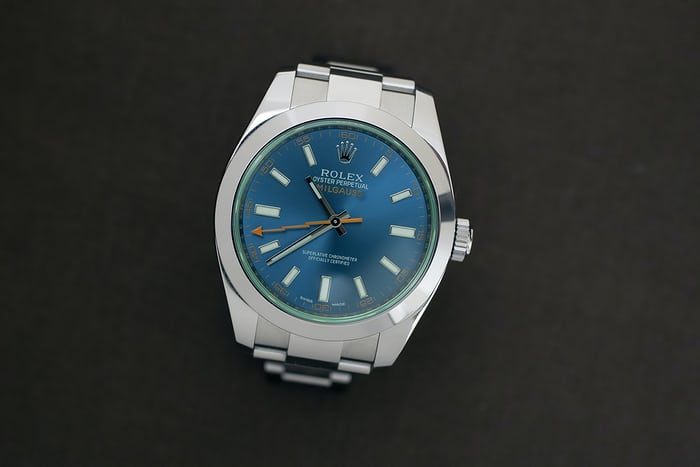 A Rolex watch on a black background