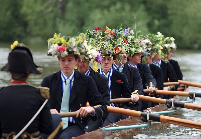 Rowers at Eton in floral headwear