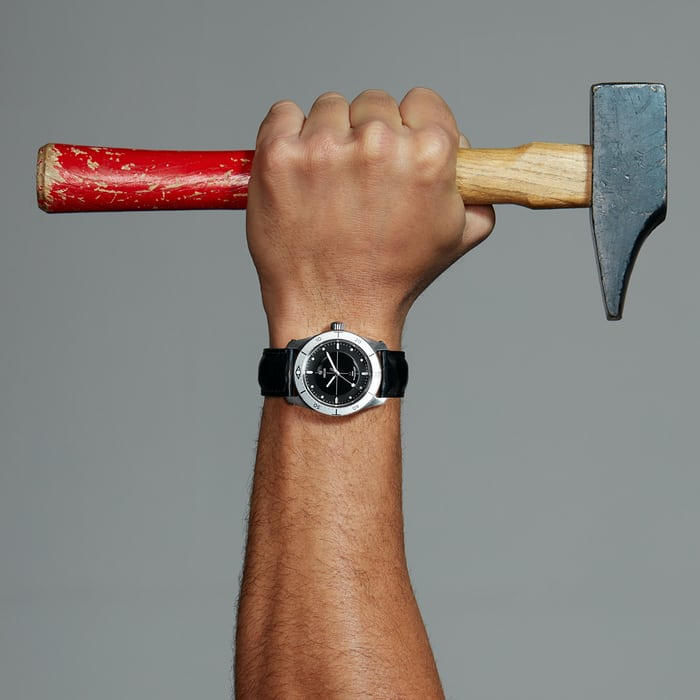 A hammer and a Hegid watch